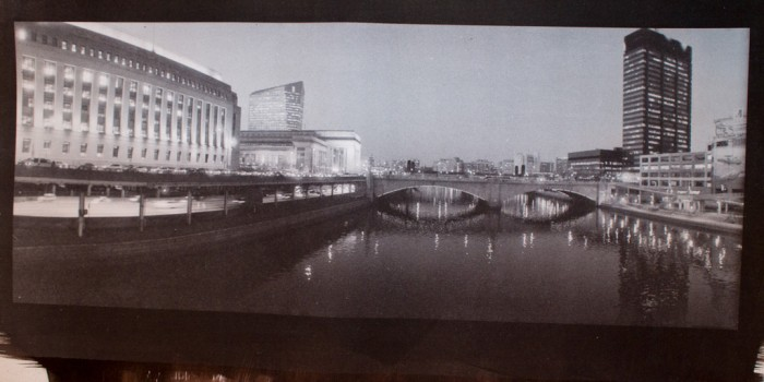 Taken this spring; Philadelphia, looking north from the Chestnut St. bridge. Gold toned kallitype on Arches HP 140#. Shot with a Widelux FV and Delta 3200, developed with Perceptol.  This gold toning is about the third reuse of 250mL of gold toner #2, toned with the same batch of toner as yesterday's print. Development was identical between the two. The color has shifted slightly warmer and is still very effective at both preserving the print (replacing silver with gold) and changing its color.